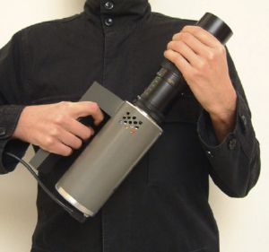 SMS Guerilla Projector - device held by man in trenchcoat with powercord up the sleeve